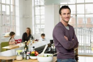 shared parenting nesting man father in kitchen kids mother in background