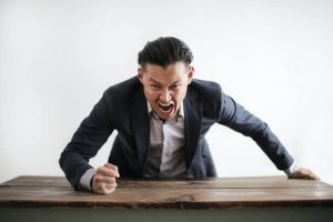 angry father beating table after losing parental rights