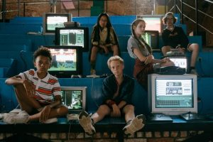 stressed out kids sitting in between tv sets