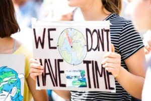 "international parental kidnapping girl with ""we don't have time"" sign"