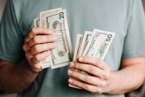 dad holding stimulus money
